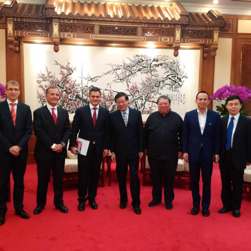 They were close business partners: Vuk Jeremic and Patrick Ho (third and fifth from left)